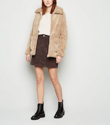 Click to view product details and reviews for Dark Brown Pocket Cord Mini Skirt New Look.
