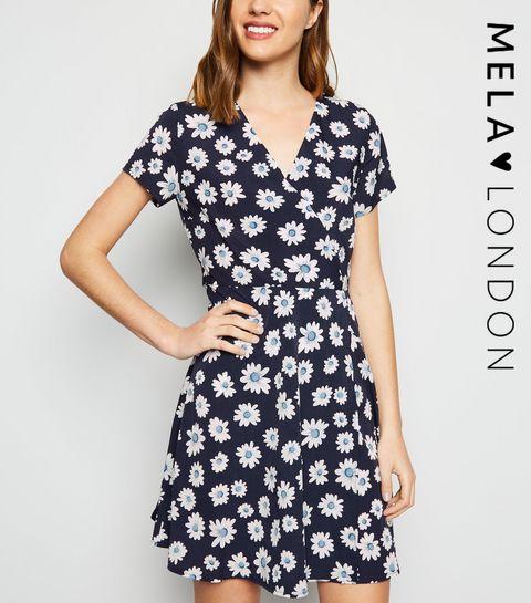 725b49d7ae24 ... Mela Navy Daisy Print Wrap Dress ...