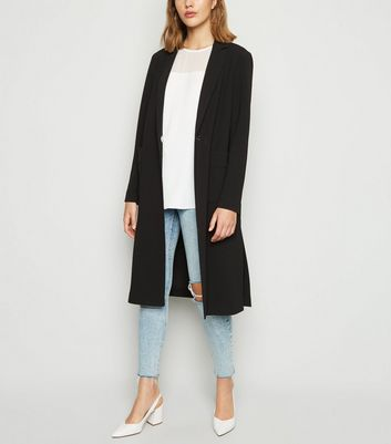 Long manteau noir texturé