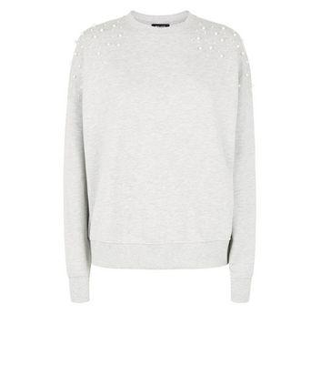 Graues Sweatshirt mit Zierperlen Für später speichern Von gespeicherten Artikeln entfernen