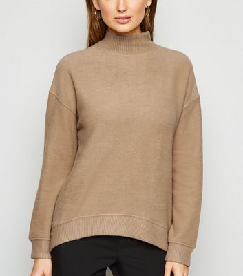 Click to view product details and reviews for Camel Brushed High Neck Jumper New Look.