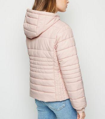 Petite Doudoune légère à capuche rose pâle   New Look