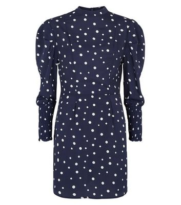 Click to view product details and reviews for Ax Paris Navy Spot Shirred Cuff Dress New Look.