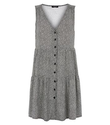 Click to view product details and reviews for Petite Black Daisy Print Mini Smock Dress New Look.