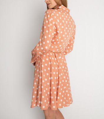 Click to view product details and reviews for Cutie London Pink Spot Tie Waist Shirt Dress New Look.