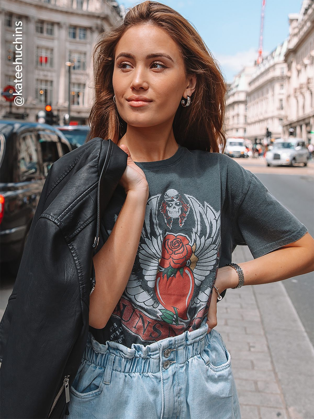 edb4ba72dd507 Influencer Kate Huchins wears a vintage style band tee with paper bag waist  shorts and a